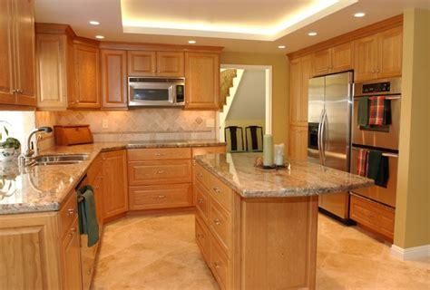 cherry kitchen cabinets  gray wall  quartz