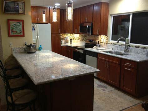 light cherry c c cabinets and granite