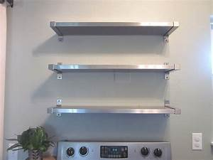 three row silver steel wall mounted shelves on white