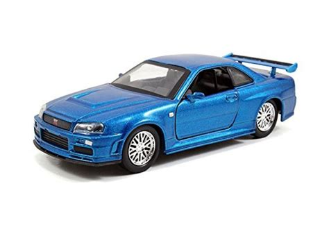 blue nissan skyline fast and furious models of movie cars nissan skyline gtr r34 2002 fast