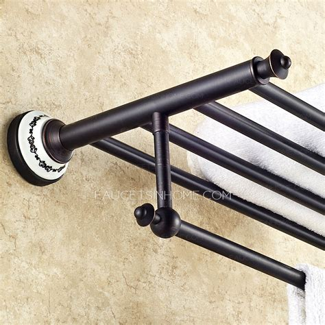 black rubbed bronze bathroom towel shelves with towel bar