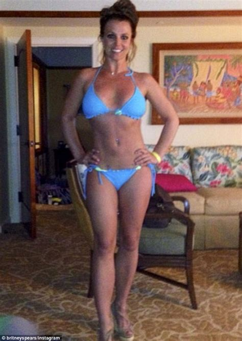 Britney Spears shows off her toned bikini body as boyfriend David Lucado and sons strike silly ...