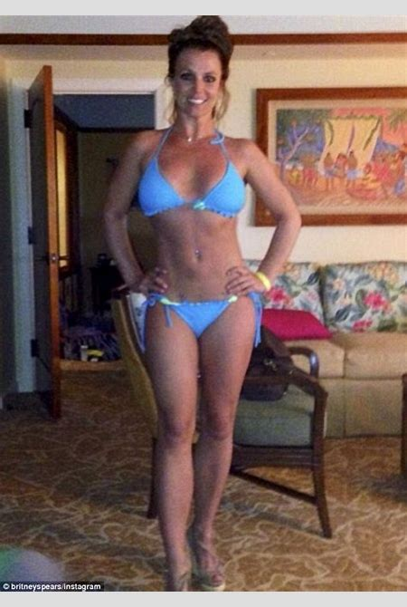 Britney Spears shows off her toned bikini body as boyfriend David Lucado and sons strike silly ...