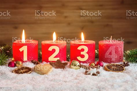 advent candles lit  snow stock photo