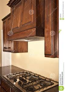 Kitchen with Range Hood Cabinet Design