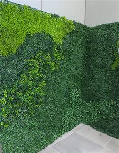 Interior and exterior artificial green wall plantings for Interior design grass wall