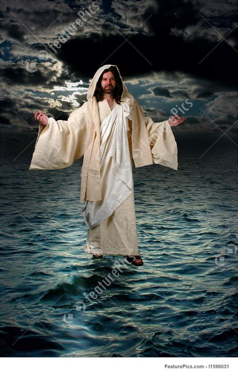 jesus walking   water stock photo   featurepics