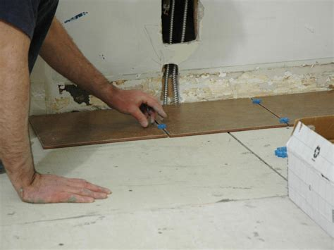 how to install a tile floor in a kitchen how tos diy