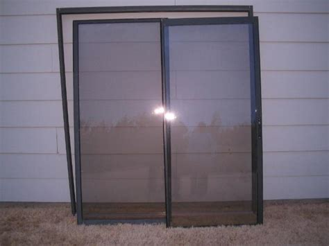 sliding multi folding patio doors with blinds between the