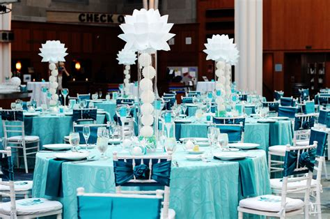 bold turquoise reception with modern centerpieces