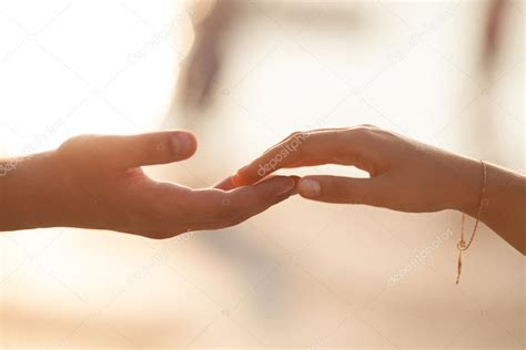 One of the ceremonies associated with this celebration is 'mehndi' ceremony. Wedding couple holding hands on sunset. — Stock Photo ...