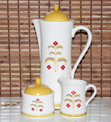 We believe in helping you find the product that is right for you. Vintage Coffee Server / Pitcher and Matching Cream and Sugar Set 1970 Cream with yellow and red ...