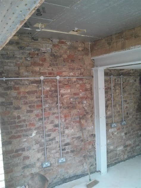 Electrical Wiring Outside by The Exposed Bricks Will Be Protected By External Wall