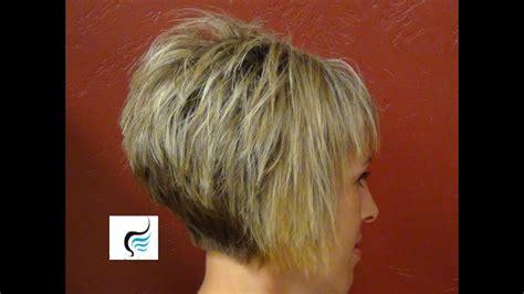 short stacked haircut  straight bangs girl