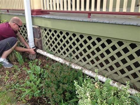 diy rain gutter watering system turn  gutter   sprinkler underground drainage