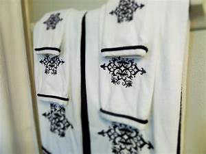 Guest bathroom decorating on a budget be my guest with for Decorating towels in bathroom