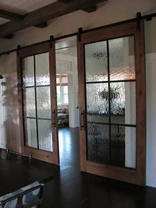 Modern and rustic interior sliding barn door designs for Barn door with glass window