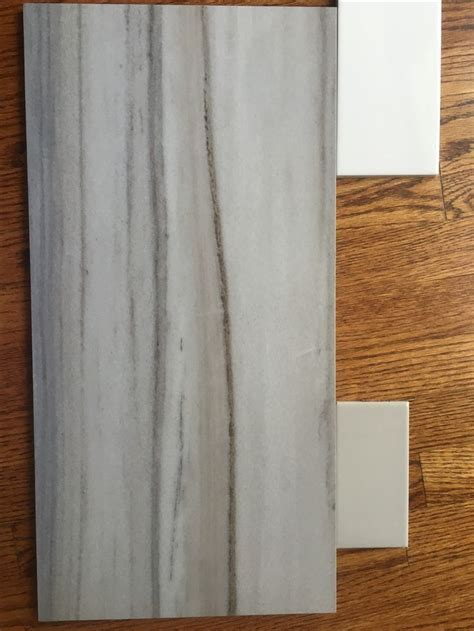 Floor, long wall of tub Daltile Marble Attache, Turkish