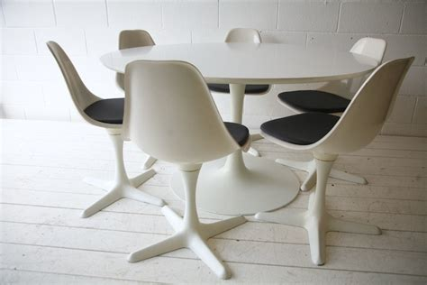 1960s dining table and 6 chairs by arkana and chrome