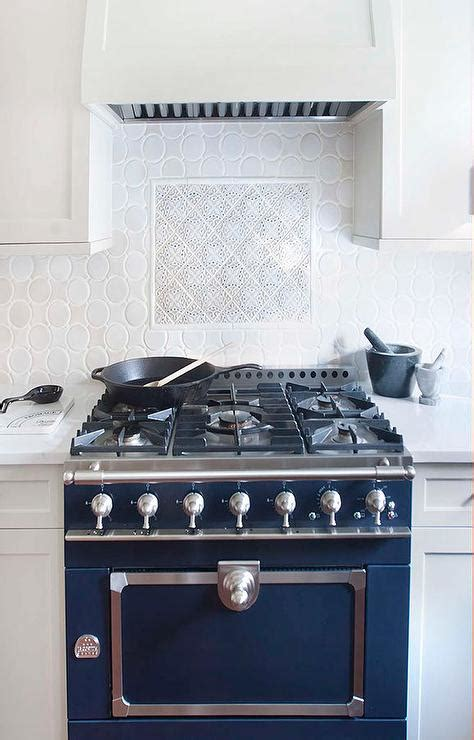 blue french stove  oval backsplash tiles transitional kitchen