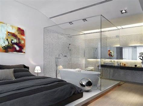 Modern Bathroom And Bedroom by A Contemporary Bedroom With An Attached Glass Bathroom And