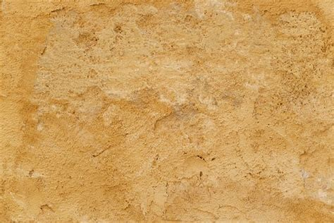 Free photo Antique Stone Wall Ancient Texture Yellow