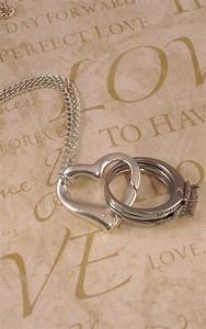 floating heart wedding engagement ring holder holding pendant With when may a wedding ring be worn when preparing food