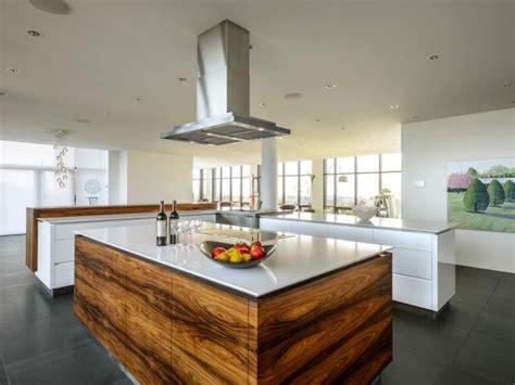 modern white kitchen  exotic wood island  black