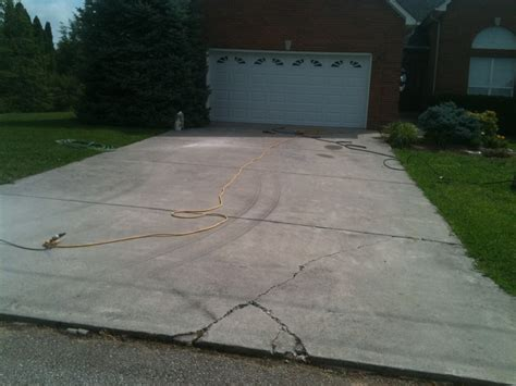 concrete driveway with spalls and cracks decorative