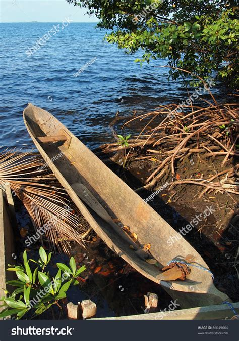 Canoes This In Panama by Amerindian Dugout Canoe Out Of Water With The Caribbean