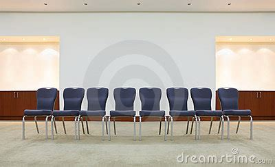 row of comfortable chairs in waiting room royalty free