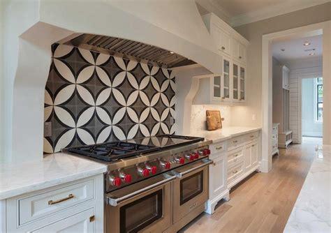 black backsplash kitchen kitchen cooktop with black and white cement circle