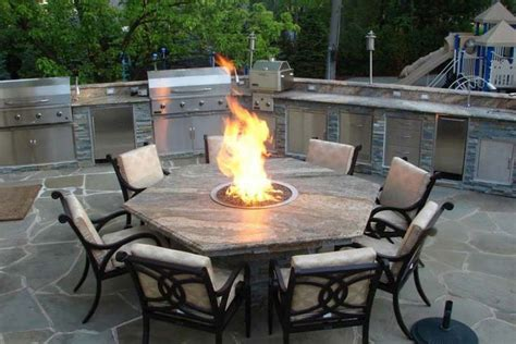 pleasant outdoor dining table  fire pit  landscape