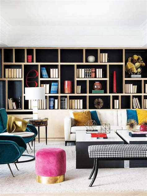 Living Room Bookshelves Modern by Clean Cut Glamor In A Apartment Pink Ottoman
