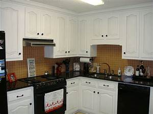off white kitchen cabinets with black appliances 1496
