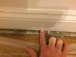 Filling gap along baseboard molding and floor for Gap between floor and baseboard