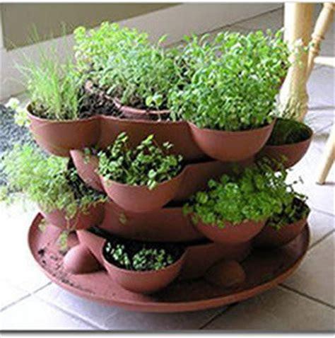 indoor herb garden stackable planter terracotta
