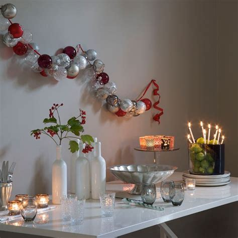 baubles hung on wall modern christmas decorating ideas