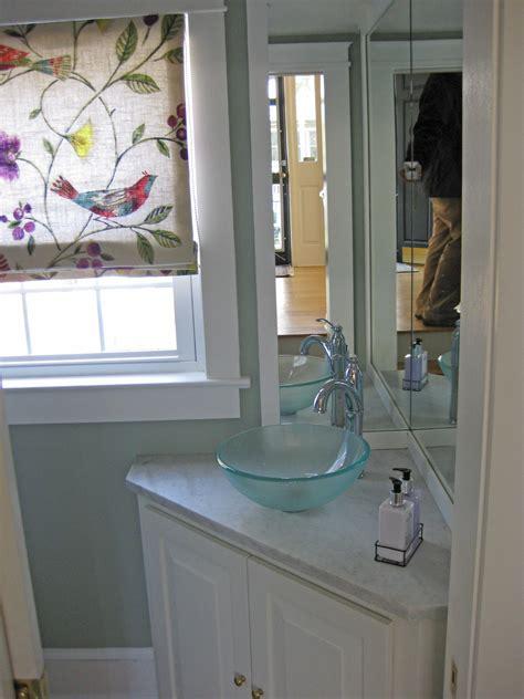 small powder room bathroom  corner vanity cabinet