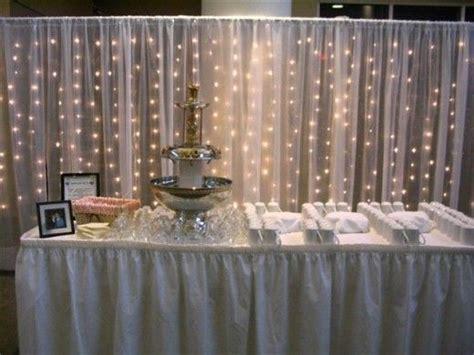 gossamer wedding decor using lights in