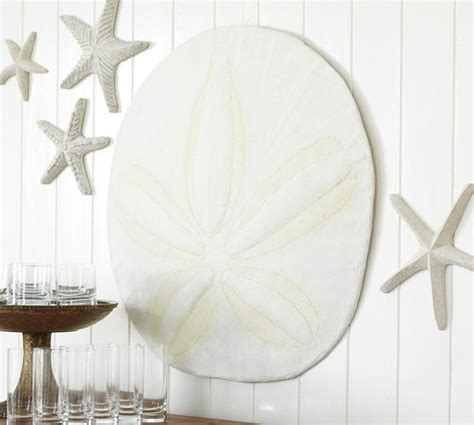 That includes wall decor, prints, framed art, and really anything that includes a sand dollar and goes on your wall. Oversized Sand Dollar | Vacation House | Room themes, Surf room, Pottery barn