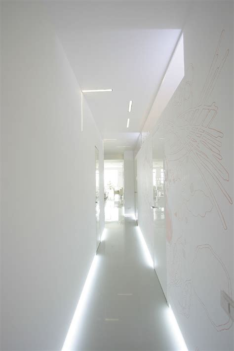 fluorescent hallway lighting on white wall and floor mixed