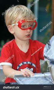 Young Boy Wearing Safety Goggles Working With A Circular ...