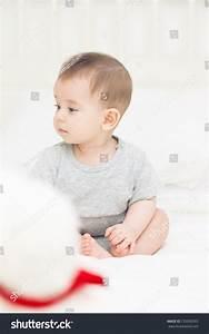 Deep Thinking Cute Baby Boy Sitting With Teddy Bear In The ...