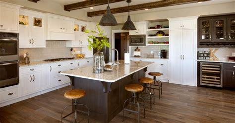 white kitchen cabinets  brown stained island