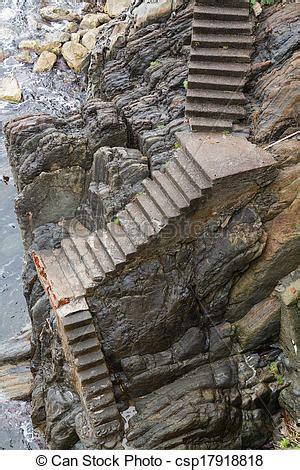 steep stone stairway worn stairs leading   ocean