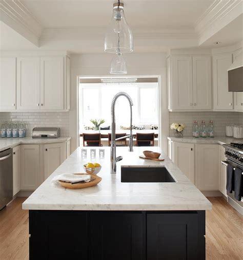 white kitchen with black island black kitchen island white marble countertop design ideas