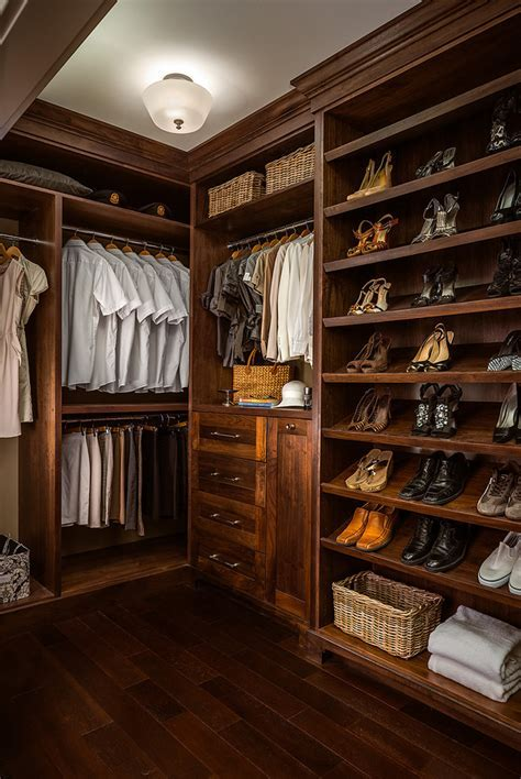 Dark crown molding closet traditional with shoe storage