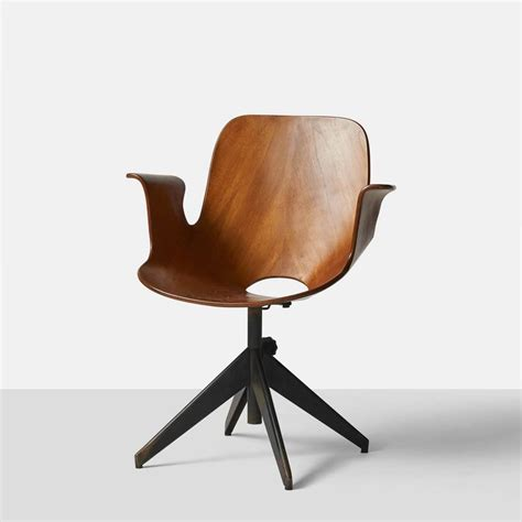 set of four vintage plywood and walnut chairs by norman cherner for plycraft at quot madea quot swivel chair by vittorio nobili at 1stdibs