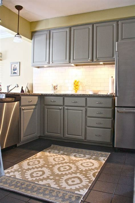 Backsplash With White Cabinets And Gray Walls by Mid Gray Cabinets With Light Yellow Walls And Accents